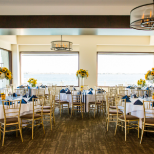 Dining room with ocean view and sunflowers