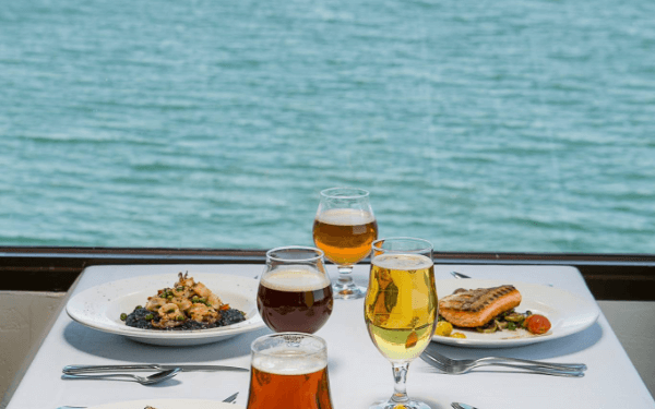 Lunch by the ocean with beer and salmon