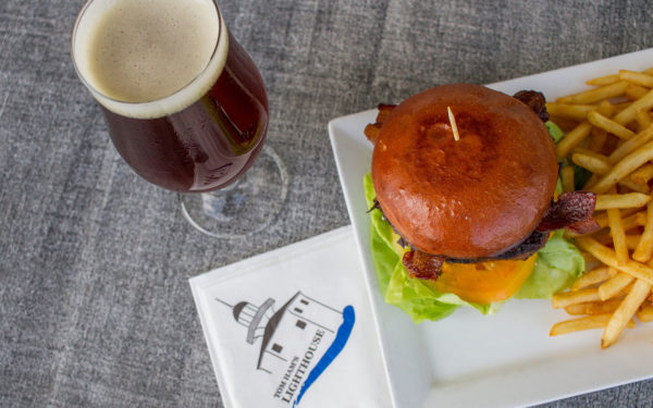 a beer with a burger and fries