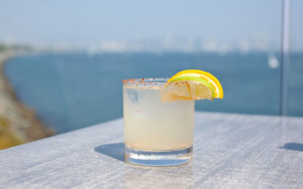 house margarita with a lemon and lime