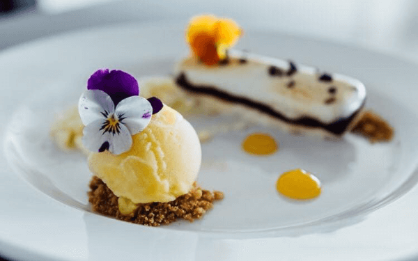 Dessert with ice cream decorated with flowers
